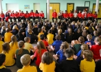 Team Canada athletes take questions from students at an elementary school in Dou